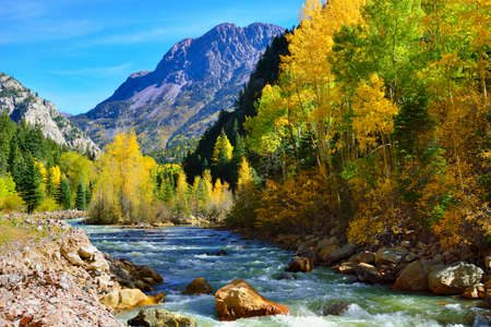 overlook: river and colourful mountains of Colorado during foliage season