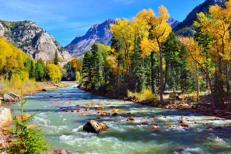 mountain river and colourful mountains of Colorado during foliage season Stock Photo