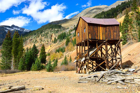 overlook: old abandoned mine in colourful mountains of Colorado during foliage season
