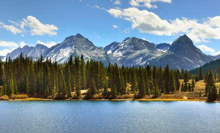 colorado rocky mountains: mountains of Colorado, a lake and clouds