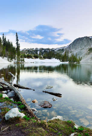 Snowy Range Mountains and lake in Medicine Bow, Wyoming during sunset in summer