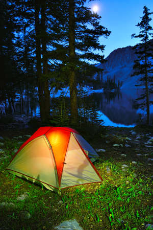 Night camping in a tent on the lake in Snowy Range Mountains in Medicine Bow, Wyoming