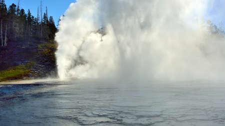 erupting Grand Geyser in Upper Geyser basin of Yellowstone National Park, Wyoming photo