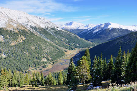 snow covered mountains: bright landscape view of the snow covered mountains and trees during foliage season in Colorado