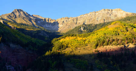 colorado landscape: mountains with snow and yellow aspen Colorado landscape Stock Photo