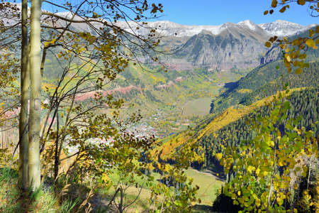 snow covered mountains: view of Telluride in the fall with yellow aspen and snow covered mountains