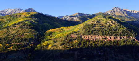 snow covered mountains: panoramic view of snow covered mountains and yellow aspen in Colorado