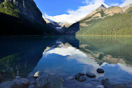 Beautiful high mountains of the Canadian Rockies as seen from Lake Louise reflecting in an alpine lake along the Icefields Parkway between Banff and Jasper