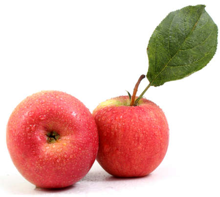 Two gala apples with leaf