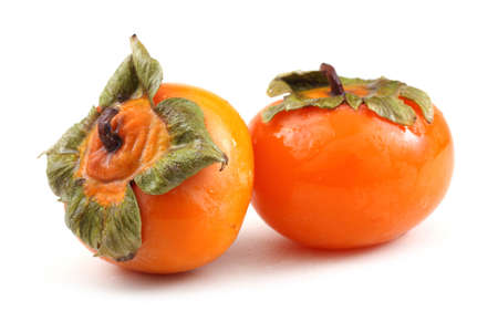Two persimmons on white