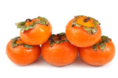 Wet persimmones Stock Photo