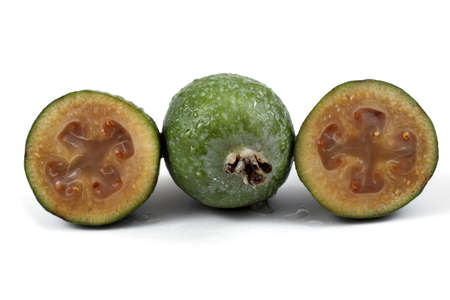 feijoa: Wet feijoa fruits with halves Stock Photo
