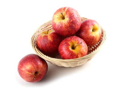 Gala apples on wicked plate Banco de Imagens