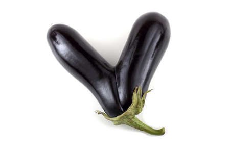 Unusual eggplant in a shape of letter V. Victory concept