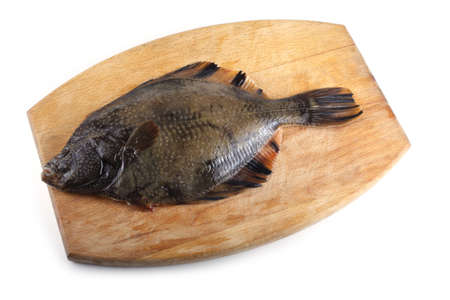 Marble flounder on cutting board