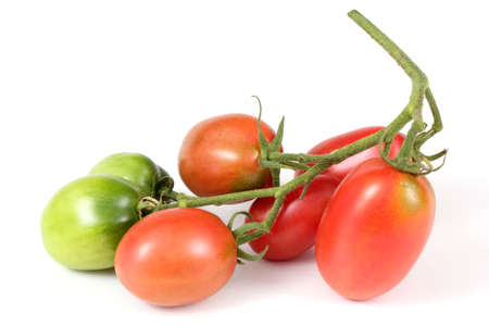 Cluster of tomatoes isolated on white