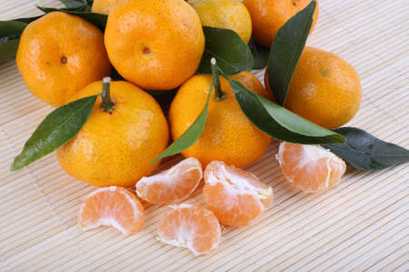 Mandarin oranges on bamboo background. Chinese style background