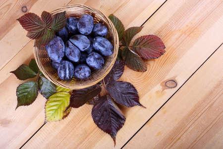Black plums on table