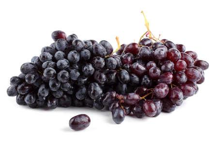 Uva negra aislado en blanco Foto de archivo