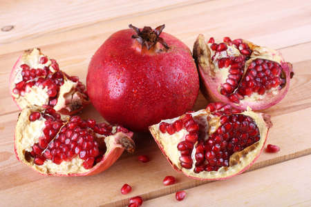 Pomegranate on table. Country style Reklamní fotografie