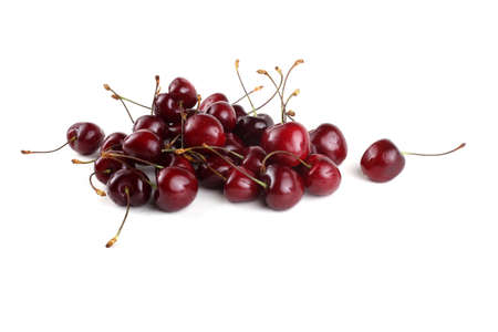 Red cherries isolated on white