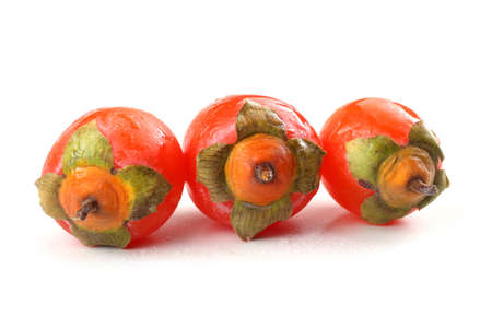 Three persimmons isolated on white