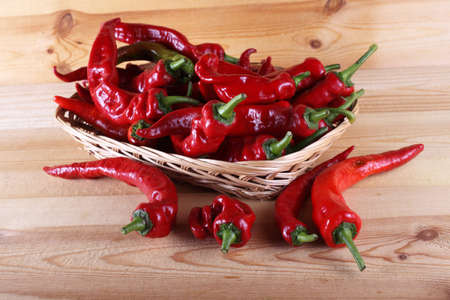 Red hot peppers on table