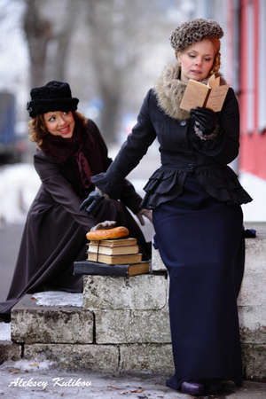 roles: Moscow, Russia - February 20, 2015 - Two student girls playing roles outside in winter.