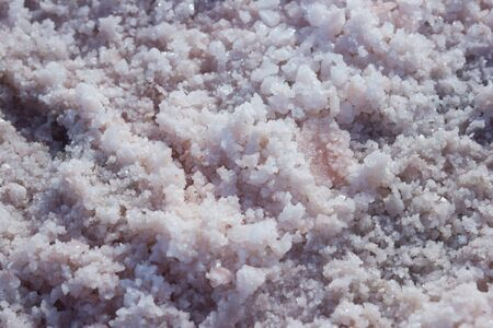 Texture of salt on the site of extraction of edible sea salt - salt background