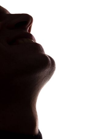 Portrait of a young man face looking up, chin view from below - silhouette