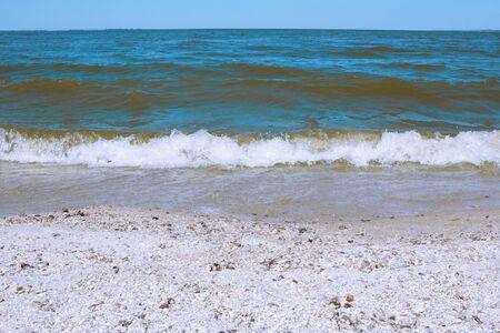 Sea wave on a sandy beach in summer Archivio Fotografico