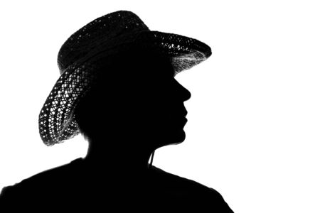 young man in a straw hat silhouette - side view Stock fotó
