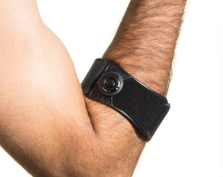 Elbow bandage on a man's hand - isolate on a white background