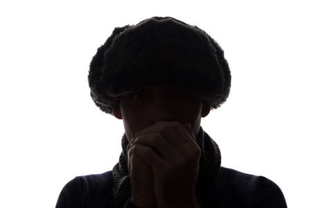 Young man in hat and gloves look ahead - horizontal silhouette of a front view Standard-Bild