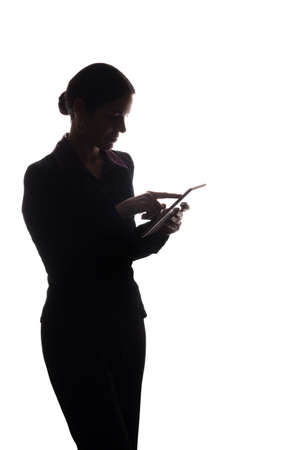 Young woman in suit look ahead and shows pointer forward - silhouette