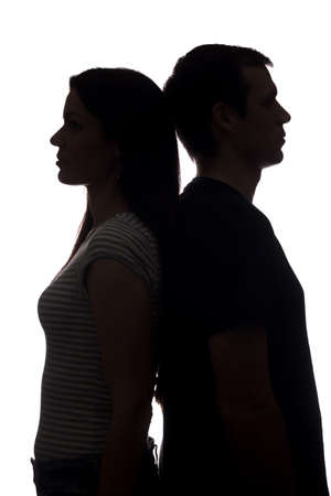 Faces women and men look in different directions, brother and sister - vertical silhouette Standard-Bild