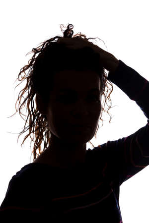 Young woman look ahead with flowing hair - isolated silhouette