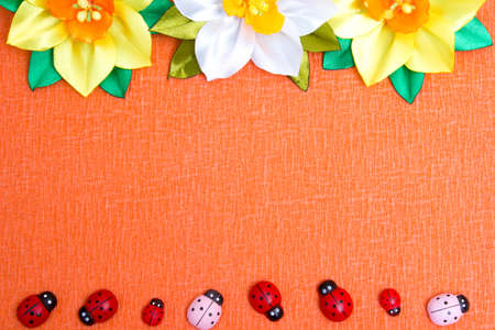 Frame of bright artificial flowers and ladybirds - a multi-colored, beautiful background Reklamní fotografie