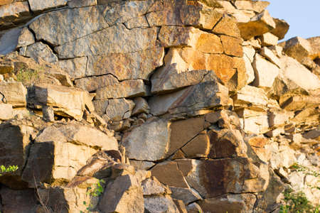 Texture of a large granite rock made of stones - marble stone quarry background