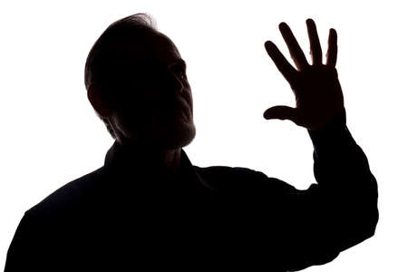 The old of a young man covers his face, protest - silhouette, concept without comment Stock Photo
