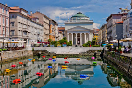 sweltering: Colorful toy-like frogs in Canal Grande on a hot sunny day in Trieste, Italy