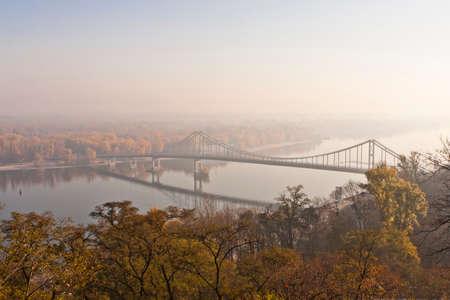 dnipro: Pedestrian Bridge on Dnipro River in Kiev in Hazy Autumn Morning Stock Photo