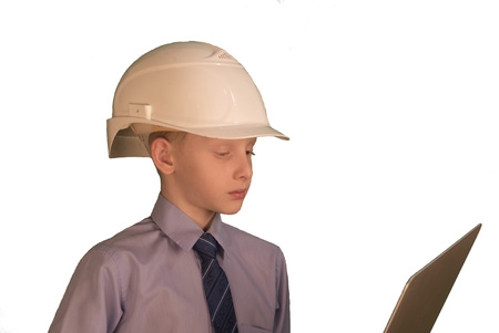 Smiling little boy wearing white hard hat and necktie with shirt on while background Stock Photo