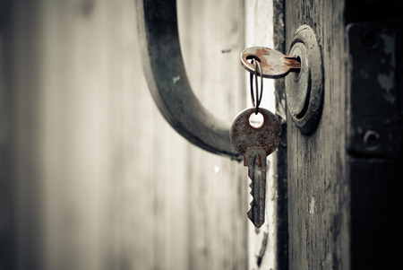 rusty keys in old door lock Stock Photo