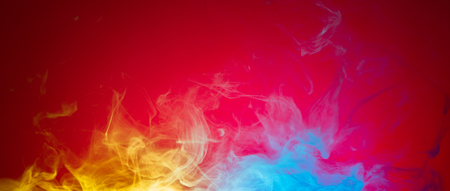 yellow and blue smoke on red background Stock Photo