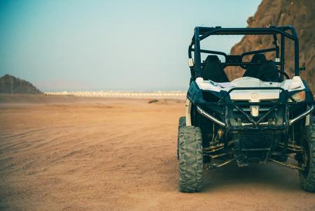 Motorcar in the mountains at Egypt desert on sunset
