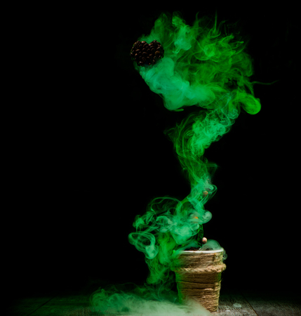 green smoke from wooden jar