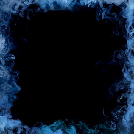 frame from blue smoke over black background