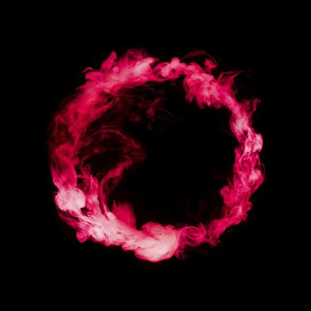 red colorful smoke circle isolated on black background Zdjęcie Seryjne