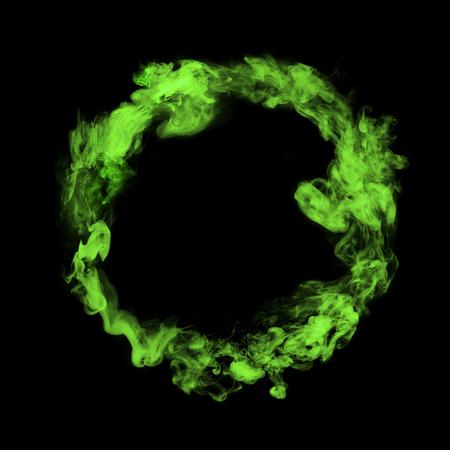 green colorful smoke circle isolated on black background Zdjęcie Seryjne